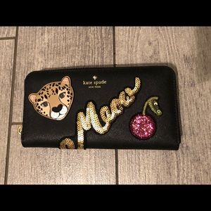 Kate spade run wild Neda sequin meow wallet